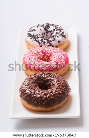 Fresh donuts on a plate