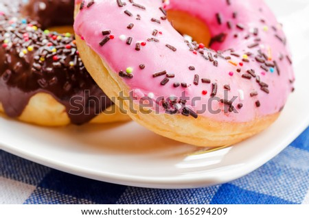 Fresh donuts on nature background. - stock photo