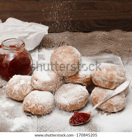 Fresh donuts with jam - stock photo