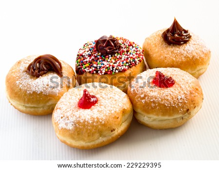 Fresh donuts with jam and chocolate for Hanukkah celebration. - stock photo