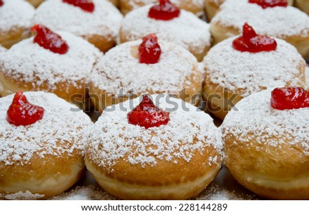 Fresh donuts with jam in the bakery for Hanukkah celebration. - stock photo