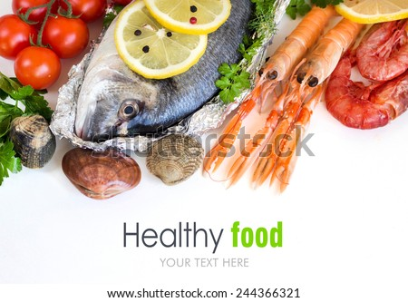 Fresh dorado fish and seafood on a white background