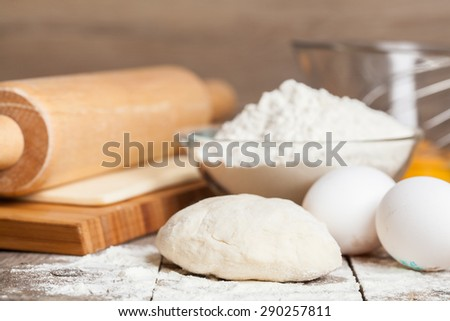 fresh dough ready for baking  on rustic wooden background. - stock photo