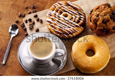Fresh doughnut and cookies with an espresso