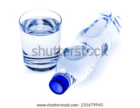 Fresh drinking water in plastic bottle and glass - stock photo