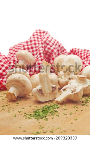 Fresh edible Portabello Mushroom Champignon and Fresh Green chopped Parsley on Kitchen Table. Sauteed Mushrooms with Parsley meal preparation. - stock photo