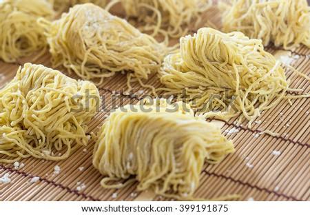 Fresh egg noodle, ramen, selective focus - stock photo