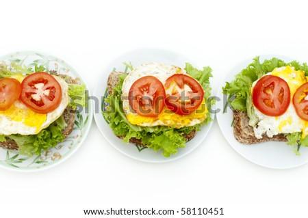 Fresh egg sandwich on plate in row - stock photo