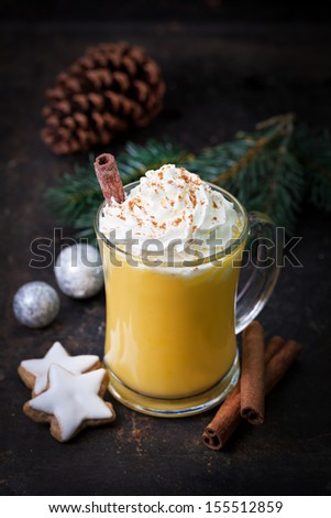 fresh eggnog with whipped cream and cinnamon  - stock photo