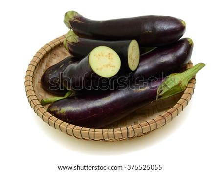 fresh eggplant fruits with half isolated on white background - stock photo