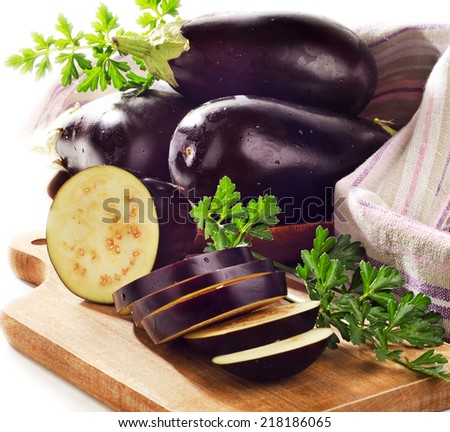 Fresh eggplants on a wooden border isolated on white . Selective focus - stock photo