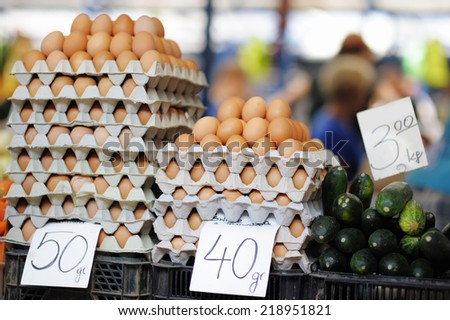 Fresh eggs and vegetables at farmers market  - stock photo