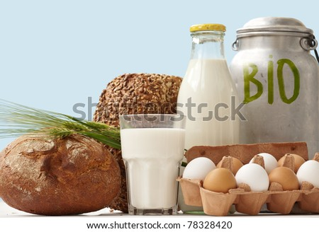 Fresh eggs, bread  and dairy products in glass and Aluminum containers - stock photo