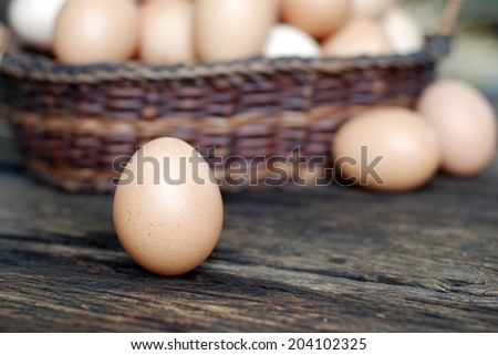fresh eggs from farm on wooden table  - stock photo