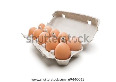 Fresh eggs in carton box - stock photo