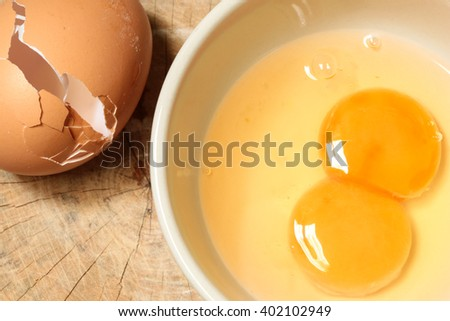 Fresh eggs on bowl