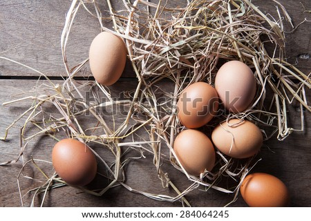Fresh eggs on rice straw at country farm, Top view, Still life  - stock photo
