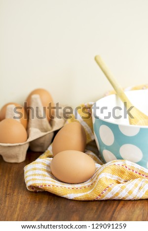 Fresh eggs on the table - stock photo