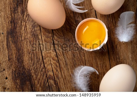 Fresh eggs on wood background. Copy space. Top view  - stock photo