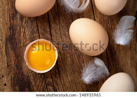Fresh eggs on wood background. Top view - stock photo