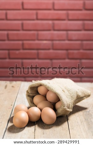 fresh eggs on wooden table background