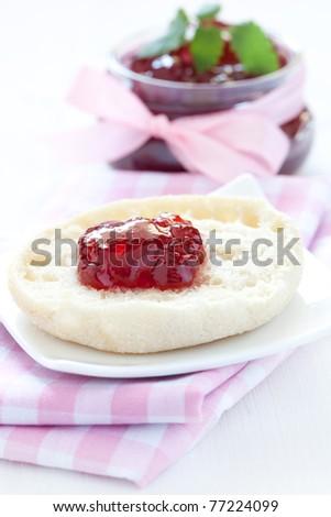 fresh english muffin with jam - stock photo