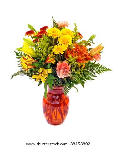Fresh fall color flower arrangement in orange vase isolated on white - stock photo