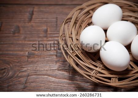 Fresh farm eggs on a wooden rustic table - stock photo