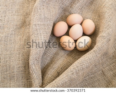 Fresh farm eggs on sackcloth ( Composition and space for text )