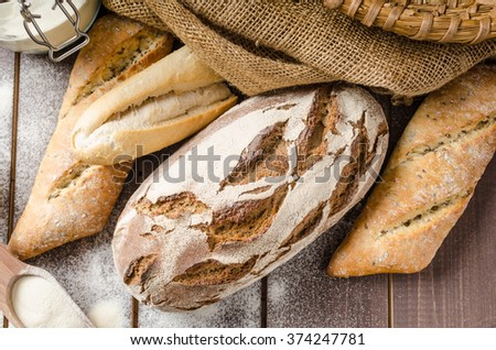 Fresh Farmer rustic style bread with pastry, baked in oven from leaven, breaded in a basket - stock photo
