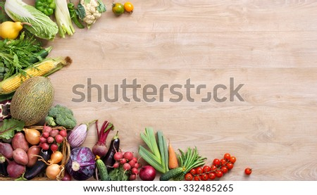 Fresh farmers market only vegetables from above with copy space / high resolution product, studio photo of different vegetables on wooden table. Copy space. - stock photo