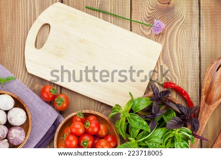 Fresh farmers tomatoes and basil on wood table. View from above with copy space - stock photo