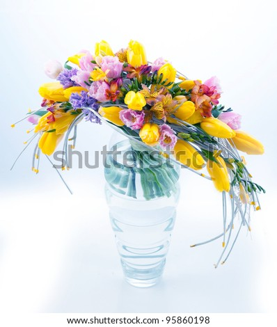 Fresh festive bouquet of flowers in vase on white background - stock photo