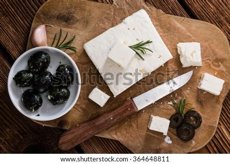 Fresh Feta Cheese (detailed close-up shot) on vintage background - stock photo