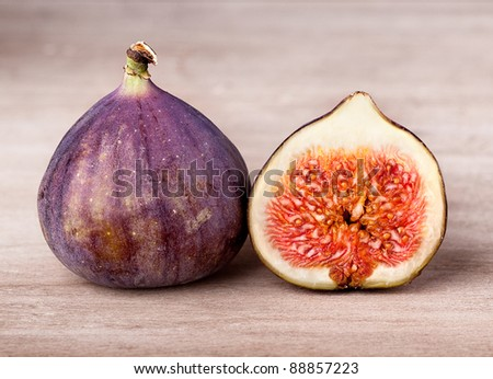 Fresh fig fruits arranged on wooden table - stock photo