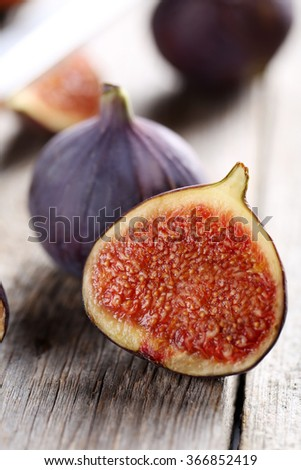 Fresh figs on a grey wooden table