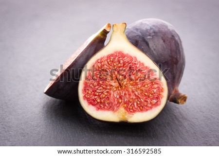 Fresh figs on black stone background - stock photo