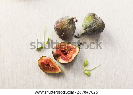 fresh Figs on wooden background - stock photo