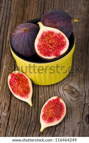 Fresh figs on wooden ground