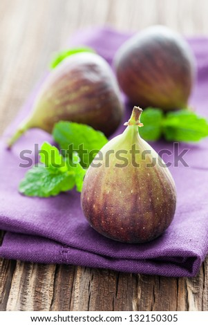 fresh figs with mint - stock photo