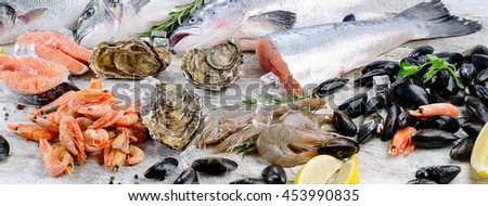 Fresh fish and seafood with aromatic herbs and spices. Healthy diet eating.