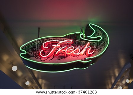 Fresh fish neon sign at Pike Place Market Seattle - stock photo