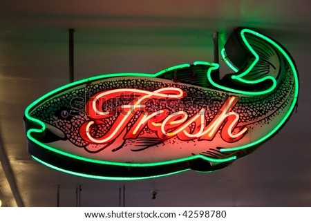 fresh fish neon sign at Seattle's Pike Place market - stock photo