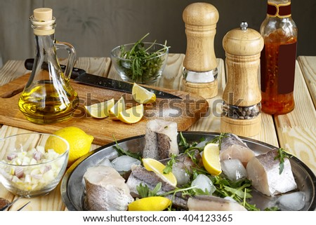 Fresh fish on a platter Soldo and greens.Closeup, healthy eating. Eco products. - stock photo