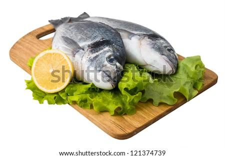Fresh fish on wooden cutting - stock photo