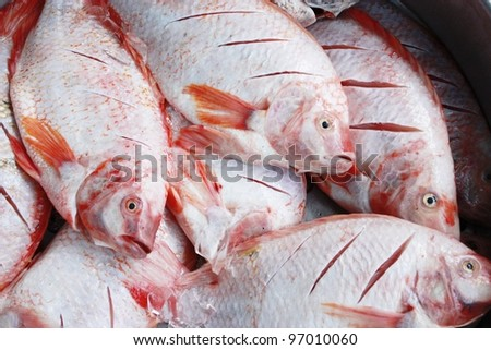 Fresh fish prepared for cooking.