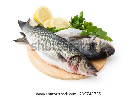 Fresh fish with lemon and parsley. Isolated on white background.