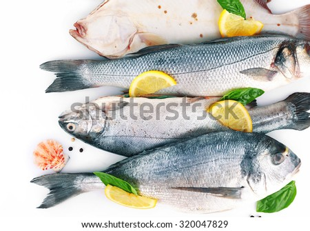 Fresh fishes and shrimps with spices  close up - stock photo