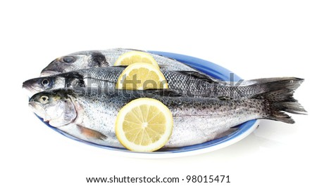Fresh fishes with lemon on plate isolated on white