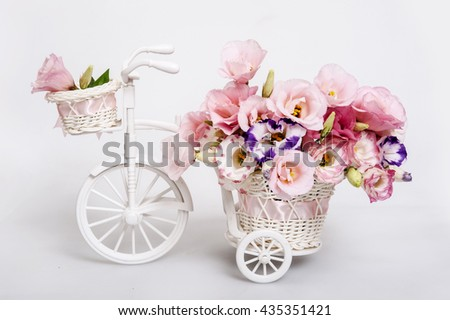 fresh flower bouquet in a decorative white carriage  - stock photo